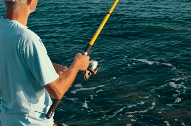 proper way to hold a fishing rod - fishing